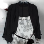 Photo of the completed shrug over the dress I intend to wear it with