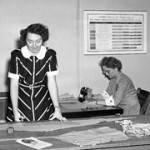 Vintage shot of woman at the cutting table