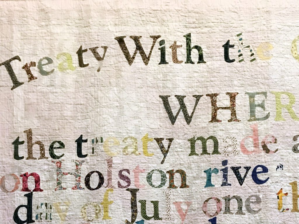 "Detail of ""Treaty With the Cherokee 1794,"" Gina Adams, 2015. Antique quilt, hand cut calico letters, cotton thread. Photo by Rachael Arnold."